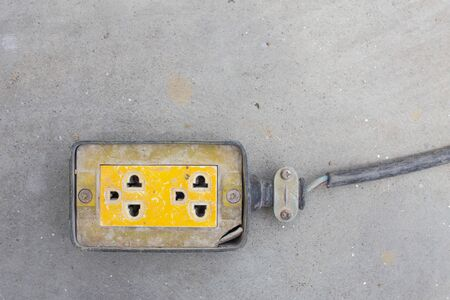 Electrical socket with power plug cable on floor for safety.electric socket outlets.