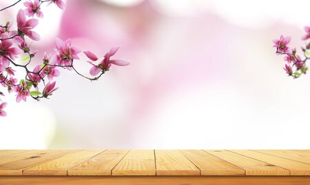 wooden table top with the nature landscape, spring flower blooming as frame and free space for text Stok Fotoğraf