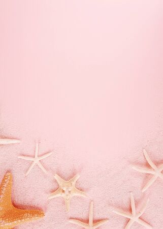 Summer concept with starfishes on pink background.