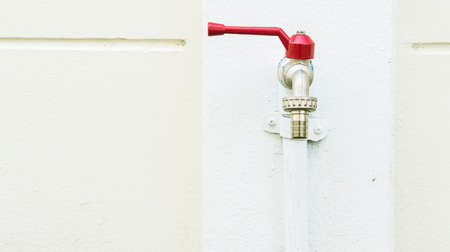 Exterior tap isolated on white wall background photo