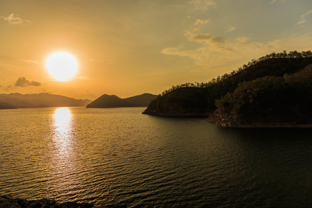 Beautiful landscape during sunset over a mountain ranges at lake in Srinakarin Dam, Kanchanaburi Province, Thailand