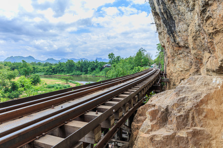 trains running on death railways track crossing kwai river in kanchanaburi thailand this railways important destination of world war II history builted by soldier prisoners Stock Photo