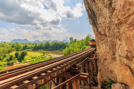 infra construction: trains running on death railways track crossing kwai river in kanchanaburi thailand this railways important destination of world war II history builted by soldier prisoners Stock Photo