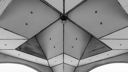 x marks the spot: Urban Geometry, looking up to glass building. Modern architecture black and white, glass and steel. X marks the spot. Abstract architectural design. Inspirational, artistic image BW. Stock Photo