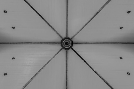 x marks: Urban Geometry, looking up to glass building. Modern architecture black and white, glass and steel. X marks the spot. Abstract architectural design. Inspirational, artistic image BW. Stock Photo