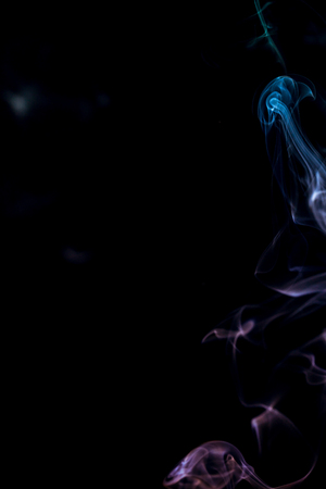 colorful smoke on dark background Stock Photo