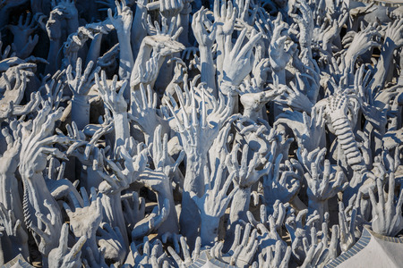 Abstract hands statue from Hell in Wat Rong Khun at Chiang Rai of Thailand Foto de archivo