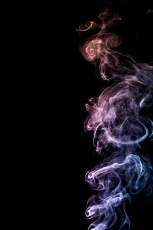 colorful smoke on dark background Фото со стока