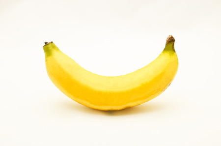 Yellow ripe banana on white background, isolated, its curved