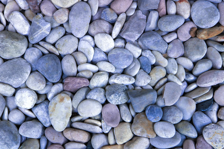 blue and gray pebbles on the beach