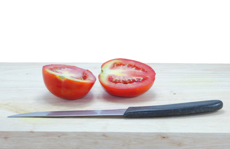 Fresh tomatoes are on the cutting board and knife, tomato isolated