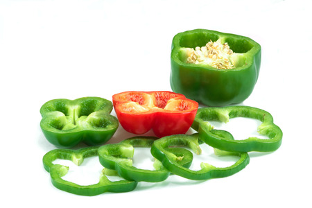 Green bell peppers surrounded Red bell pepper.