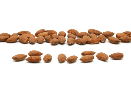 Almond pile lay on white background