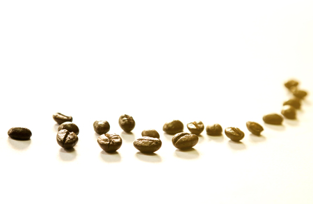 The four coffee beans are in focus.Other are out of focus.