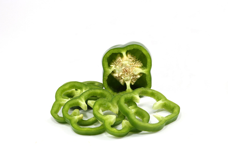 Green sweet peppers are on white background.It was cut into thin slices. Imagens