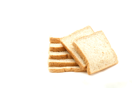Whole wheat bread sliced isolated on white background. Imagens