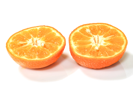 The two sliced orange on white background.