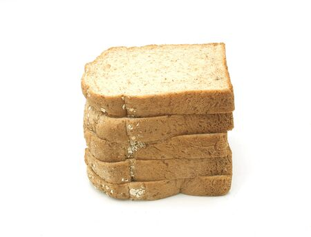 Whole wheat grain bread Stacked on white background, isolated