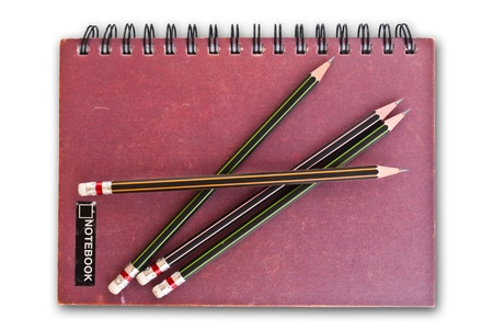 Notebook on the white with pencils. Stock Photo - 8823897