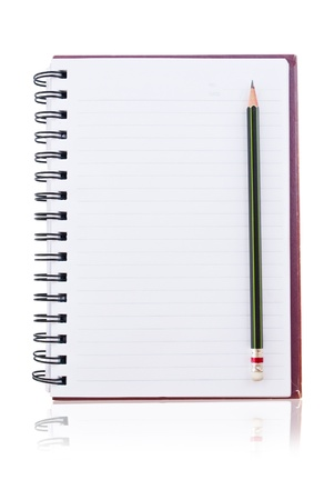 white paper of notebook with pencil. photo