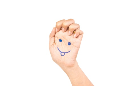 Smile on the hand for happy concept. Stock Photo - 9506198