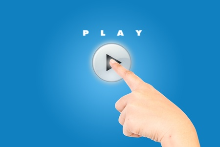 Single finger pressing play button. photo