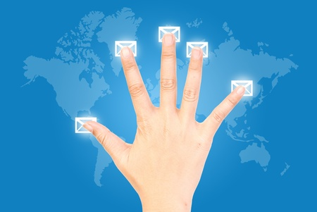 Five fingers pressing mail in world wide. photo
