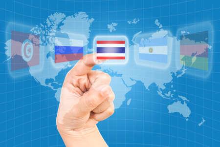 Single finger pressing flag on world wide. photo