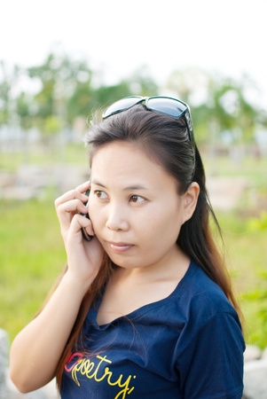 Lady phone in the park. Stock Photo - 9683549