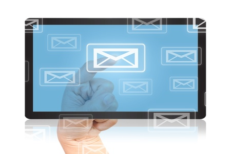 Hand pressing mail world wide on the tablet. Stock Photo - 9805591