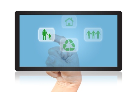 Hand pressing recycle icon on tablet . photo
