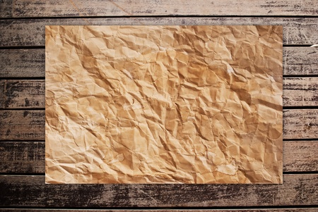 Vintage paper on the classic wood texture background. photo