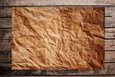 Vintage paper on the classic wood texture background. Stock Photo - 9954875