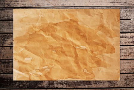 Vintage paper on the classic wood texture background. Stock Photo - 9954868