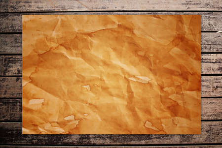 Vintage paper on the classic wood texture background. Stock Photo - 9954877