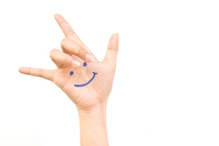 Smile on hand isolate on the white. Stock Photo - 9954931