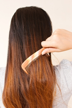 Lady to comb her hair. Stock Photo - 10047001