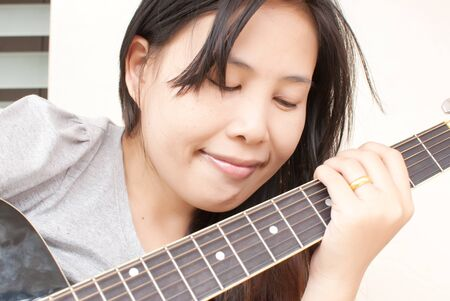 Lady playing classic acoustic guitar. Stock Photo - 10047004
