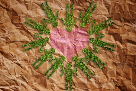 Grass people symbol heart on vintage texture background. Stock Photo - 10081727