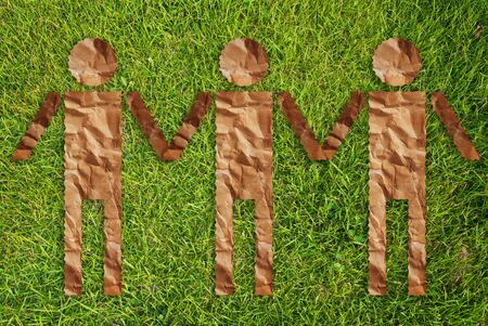 Vintage people symbol on the grass field. Stock Photo - 10081729