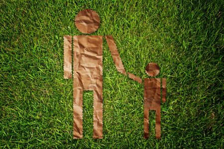 Vintage man and child symbol on the grass field. Stock Photo - 10103946