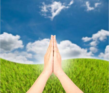 Hand greet on the blue sky. Stock Photo - 10216673