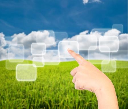 sky metaphor: Hand pressing transparent button on the blue sky field.