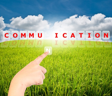Hand pressing communication word for business concept.