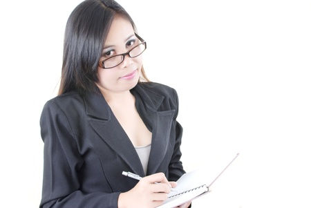 Business lady wrote on the notebook. Stock Photo - 10344412