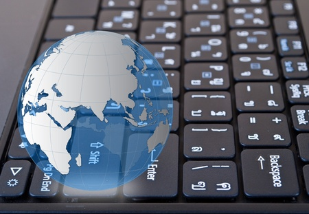 Globe on laptop keyboard. photo