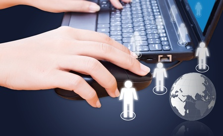 Hand pushing laptop keyboard with social network. Stock Photo - 10886036