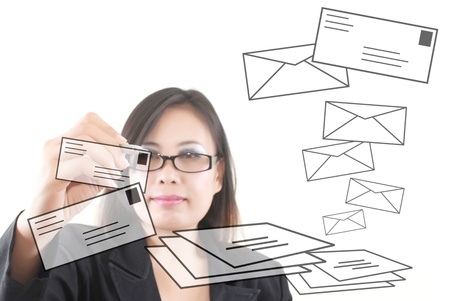 Asian business lady writing mail for social network. Stock Photo - 10918300