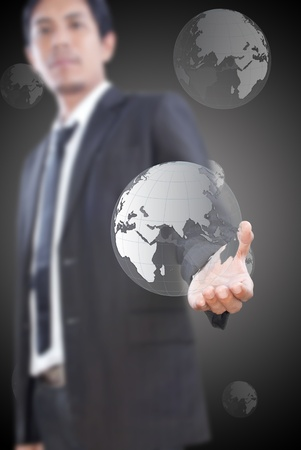 Asian man pushing globe on the whiteboard. photo