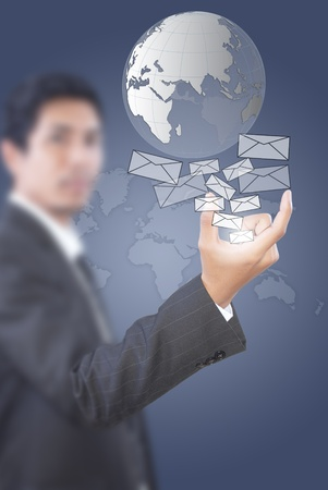 Hand pushing mail and globe for social network. Stock Photo - 10953873
